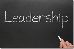 Writing leadership on a blackboard.